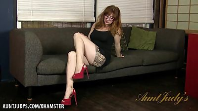 Curvy mature Amber Dawn seductively..